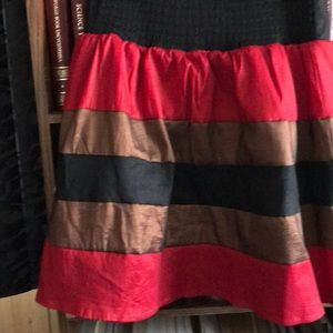 Black skirt with red and bronze layers